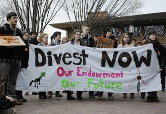 Students at Tufts University marching in support of fossil fuel divestment on March 4, 2013 (Photo credit: James Ennis).