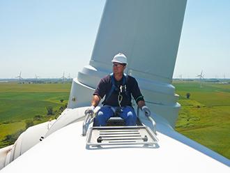 Rep. Bruce Braley (IA) sitting on a wind turbine in Iowa