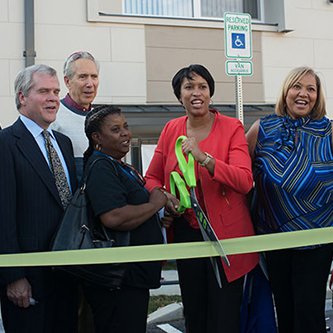DC Mayor Muriel Bowser at the ribbon-cutting ceremony for the Harry and Jeanette Weinberg Commons. EESI Chairman Jared Blum is the second from the left (Photo by Khalid Naji-Allah)