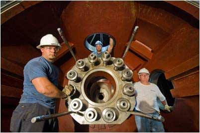 Workers rehabilitating a runner hub at American Electric Power's Racine Hydro Station. Photo courtesy Voith Hydro